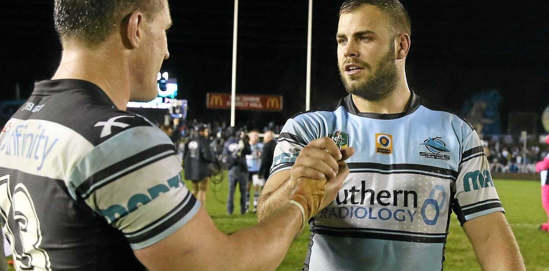 Wade Graham of the Sharks (right) is congratulated by teammate Paul Gallen after being named in the NSW State of Origin team