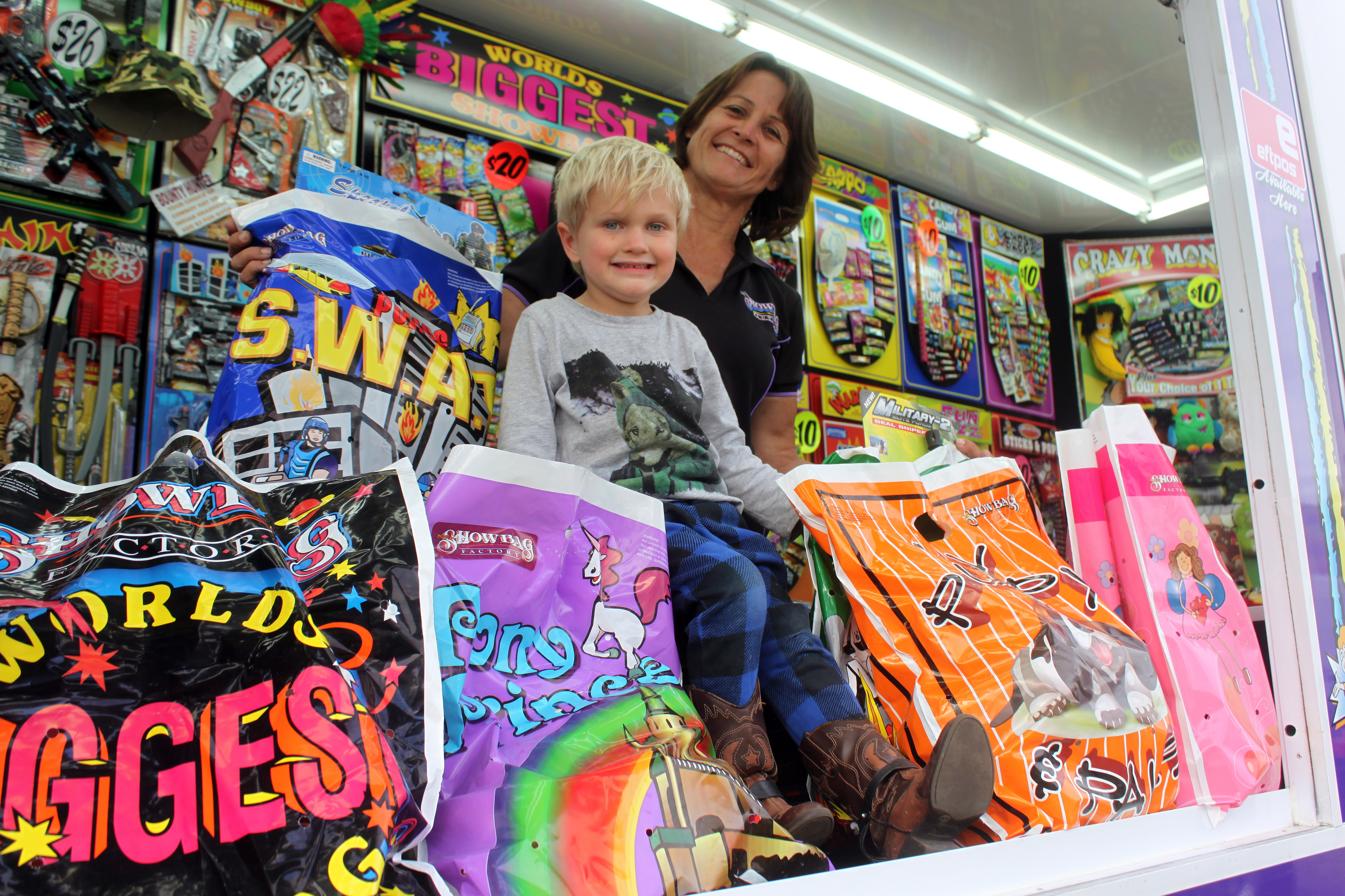 Brock Richards, 3, couldn't be happier among the countless showbags available at the Showbag Factory. Pictured with his aunt, Shelley Pink.