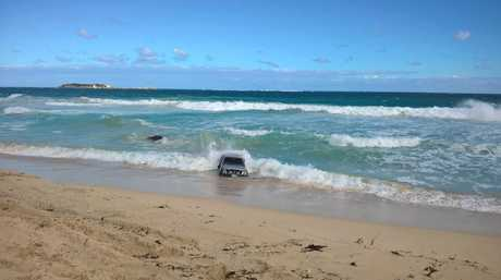 Two vehicles being consumed by waves in Western Australia had to be recovered by the SES.