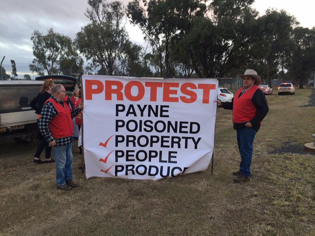 Oakey resident of 25 years Peter Jones, whose house neighbours the base, and David Jefferis of Berwick Stud hold the sign leading to the base this morning.