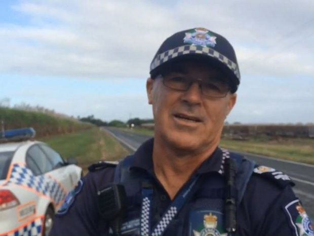 Mackay District Duty Officer (DDO) Mark Sweetnam at the scene of a tractor and train crash on private property at Homebush.