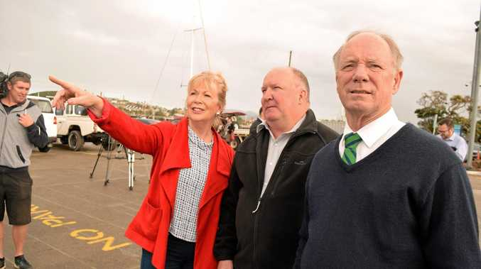 Mayor Denise Knight, NSW State Recovery Coordinator Dave Owens and Coffs Harbour MP Andrew Fraser inspect damage at Coffs Harbour Marina.