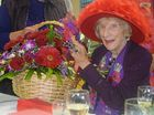 Florence Slattery with the big basket of flowers gifted to her for her 100th birthday from her beloved Rose City Red Hatters. Photo Jayden Brown / Warwick Daily News