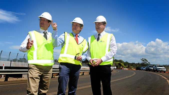FUNDING SPAT: Member for Page Kevin Hogan (centre) defends the Coalition's record on funding for the Pacific Hwy.