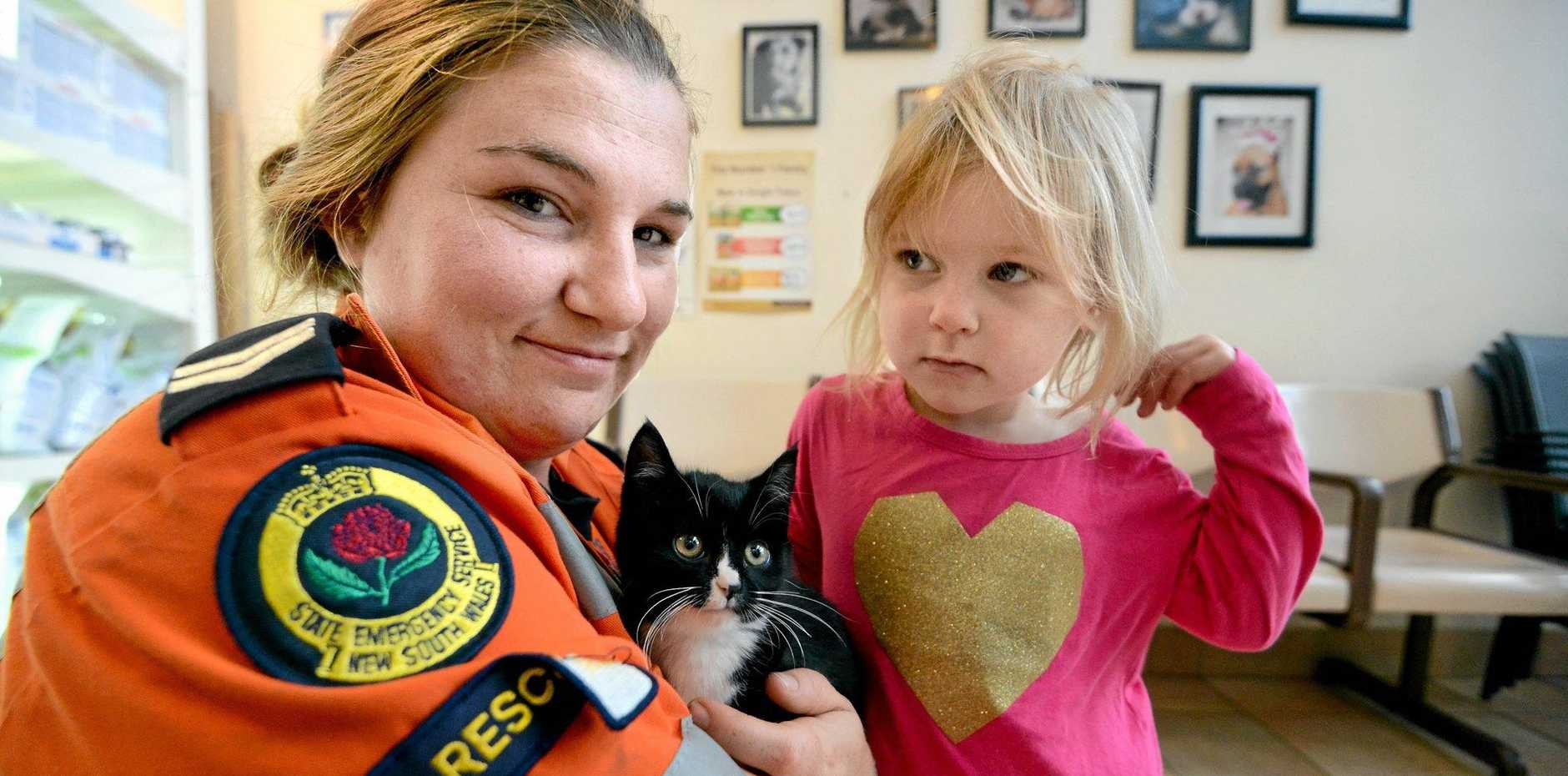 SAFE AND SOUND: Cheyne Paul from the Lismore SES and her daughter Skyla are giving Wilson the kitten a home.