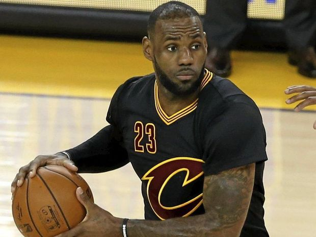 RECORD HAUL: Cleveland Cavaliers forward LeBron James (left) is pressured by the Golden State Warriors' Andre Iguodala.