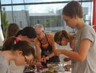 Peta Lloyd works with young students at one of The Mill Gallery workshops.