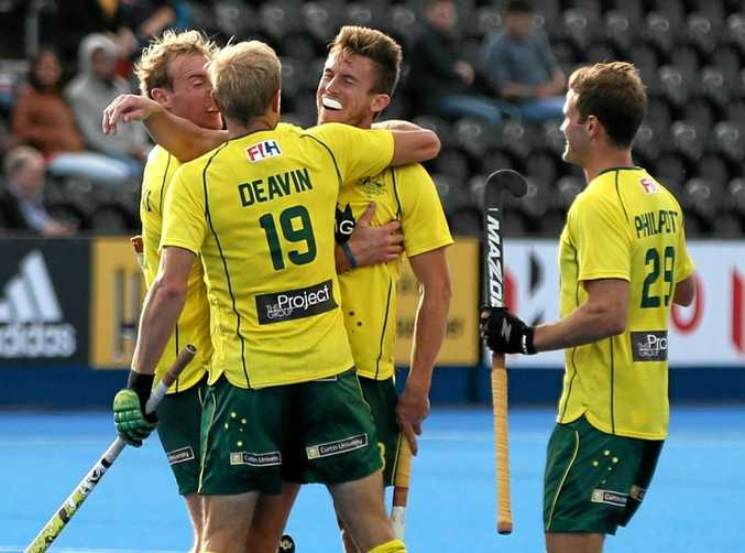 WINNING RUN: Australia's Tristan White (second from right) celebrates scoring his side's second goal of the game against Belgium during day four of the Champions Trophy at Queen Elizabeth Olympic Park in London.