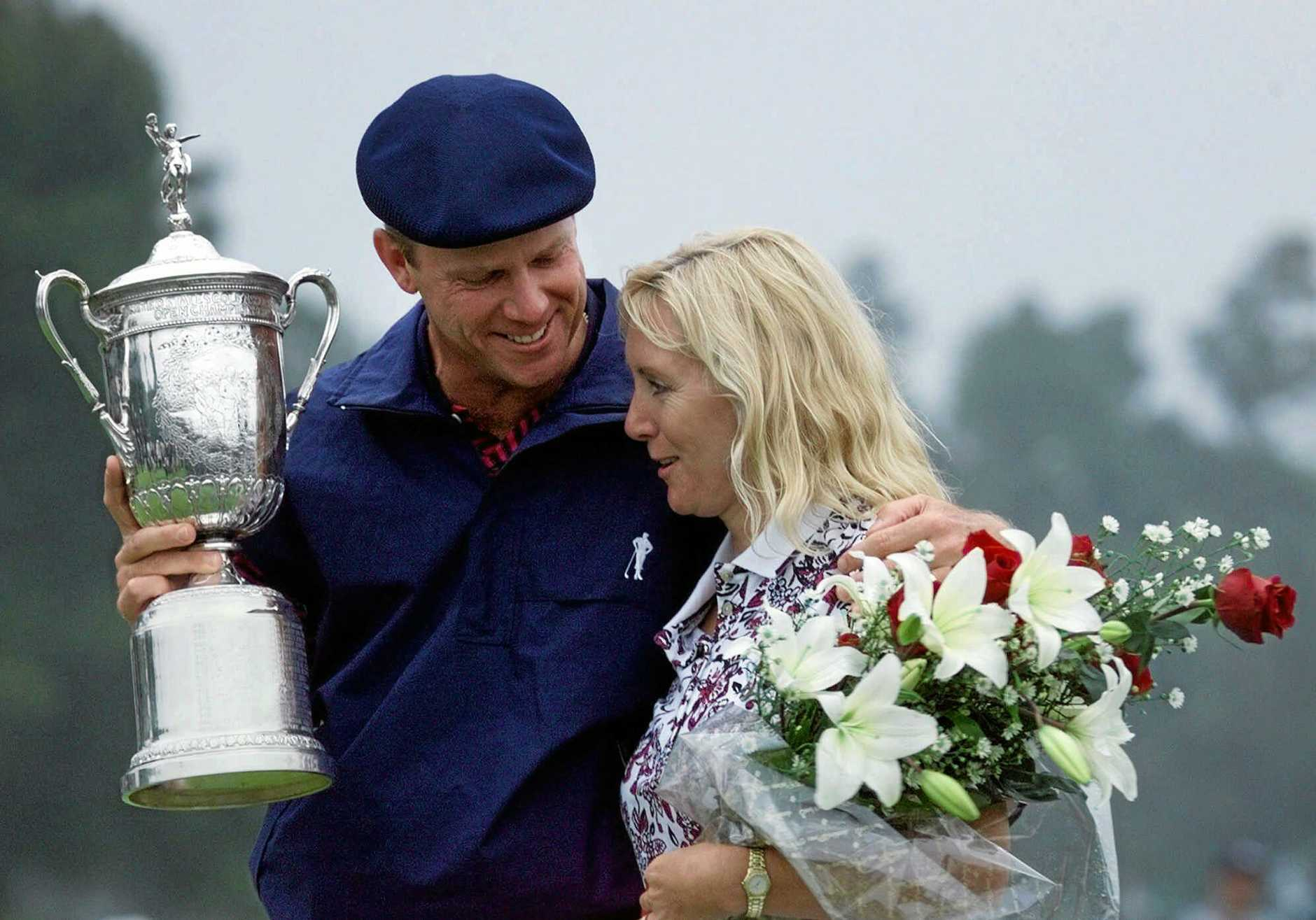 Payne Stewart holds onto his wife, Tracey Ferguson, and the winner's trophy after winning the U.S. Open golf championship at the Pinehurst Resort & Country Club's No. 2 course in Pinehurst, N.C. on Sunday, June 20, 1999. (AP Photo/Doug Mills)