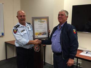 Rural firie receives an award for service to brigade