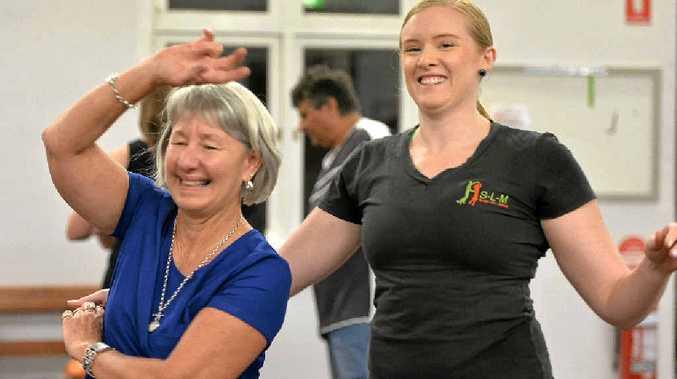 Laurelle Kelland twirls around Lenetia Stretton during their Tuesday bachata class.