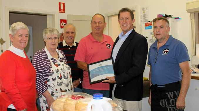 Federal Member for Cowper Luke Hartsuyker presents a National Volunteers Award to Phil Crofts of the Coffs Harbour Uniting Church Soup Kitchen.