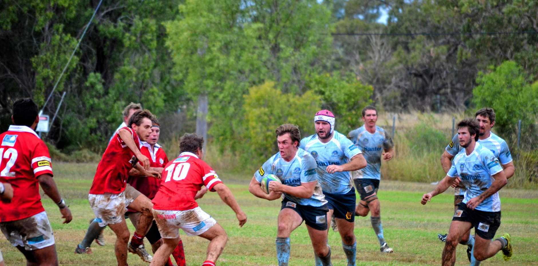 CHARGE: Roma captain Andrew Fuller winds up to hit the St George defence.