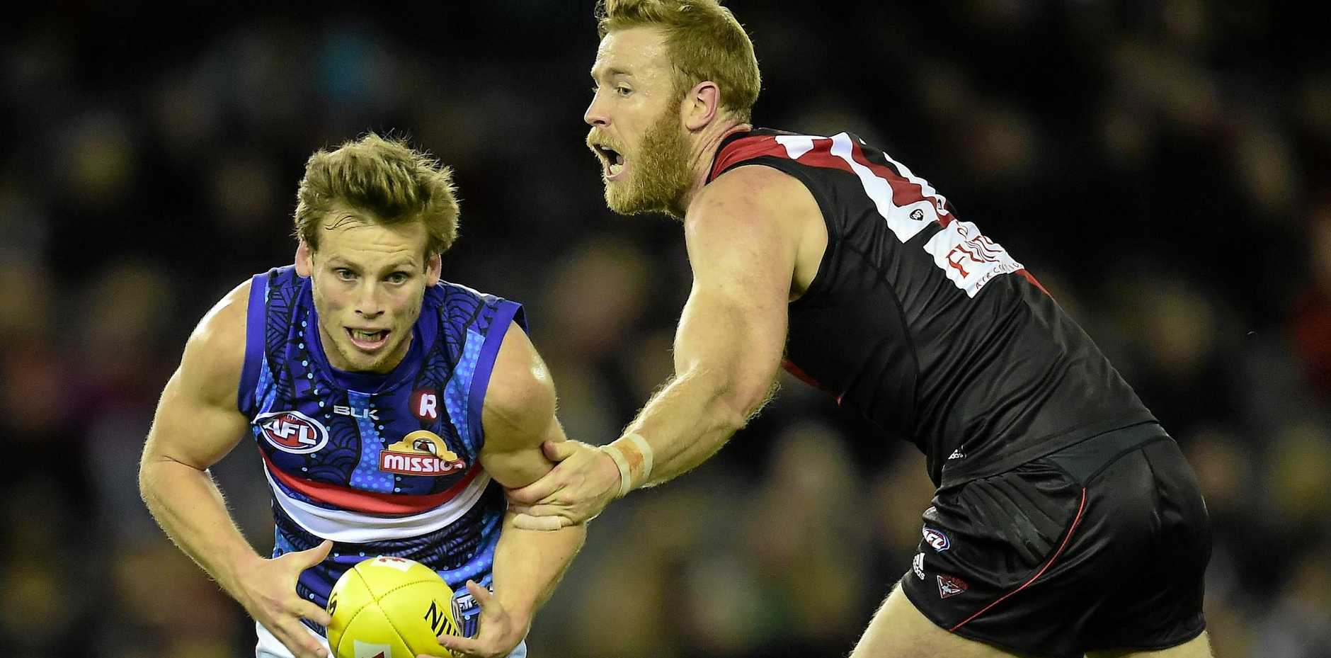 JOURNEYMAN: Jon Giles (right) in action for Essendon last year.
