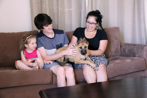 HOME SWEET HOME: Matthew Evans and partner Yvette Espinoza-Araya with their daughter Amelia and pet dog Lucky have been warmly welcomed into Gracemere after moving from Melbourne to their new home.