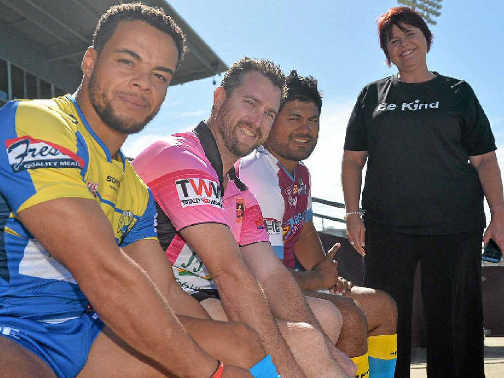 Souths Sharks player Curtin Cunningham referee Anthony Anderson and Cutters player Wiremu Weepu wearing special socks to help support Run For Mi Life with founder Jo Shanks.