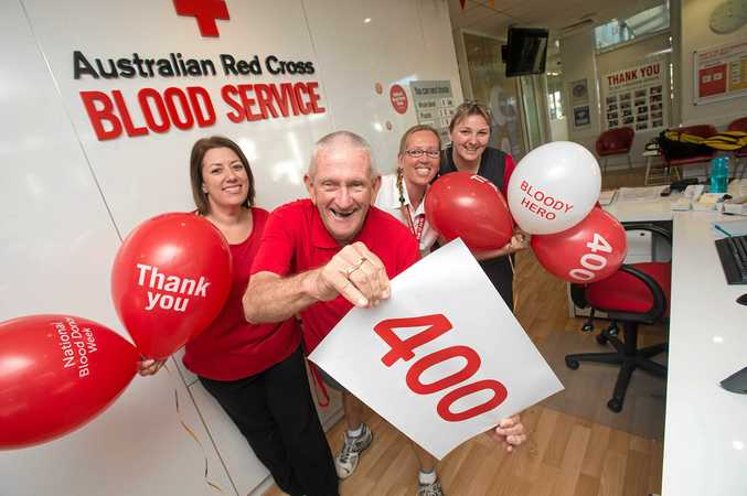 THANK YOU: Rex Holloway gets an 'A-plus' from Brooke, Jacqui and Sue of Coffs Harbour Donor Centre for his  blood donations.