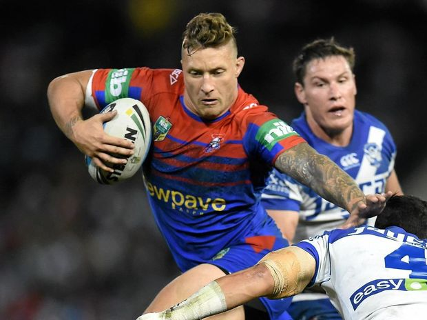 MOVED ON: Tariq Sims fends off a tackle while playing for his old club Newcastle.