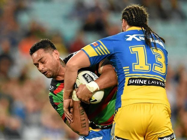 SANDWICHED: John Sutton of the Rabbitohs is tackled by Isaac de Gois and Tepai Moeroa of the Eels.