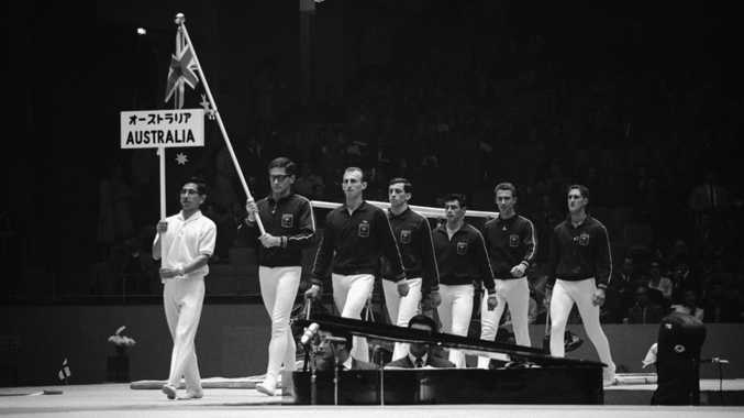 LEADING OUT: Wondai-born Graham Bond leads the Australian gymnastic team Douglas McLennan (NSW), Benny de Roo (NSW), Barry Cheales (QLD) and Ted Trainer (NSW) in the 1964 Tokyo Olympic Games behind Japanese Australian gymnastic bearer Okamura San.