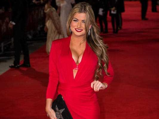 Zara Holland poses for photographers upon arrival at the premiere of the film