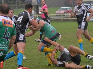 Players slip, slide and glide towards a win in the rain