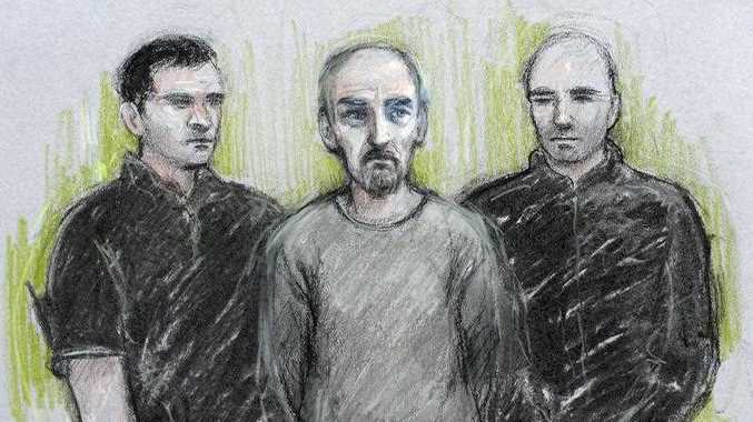 This courtroom sketch by Elizabeth Cook shows Thomas Mair, center, appearing at Westminster Magistrates Court, London, Saturday June 18, 2016, charged with the murder of British Member of Parliament Jo Cox. Labour Party lawmaker Cox, 41, was shot and stabbed to death Thursday after getting out of her car in the town of Birstall in her home constituency.