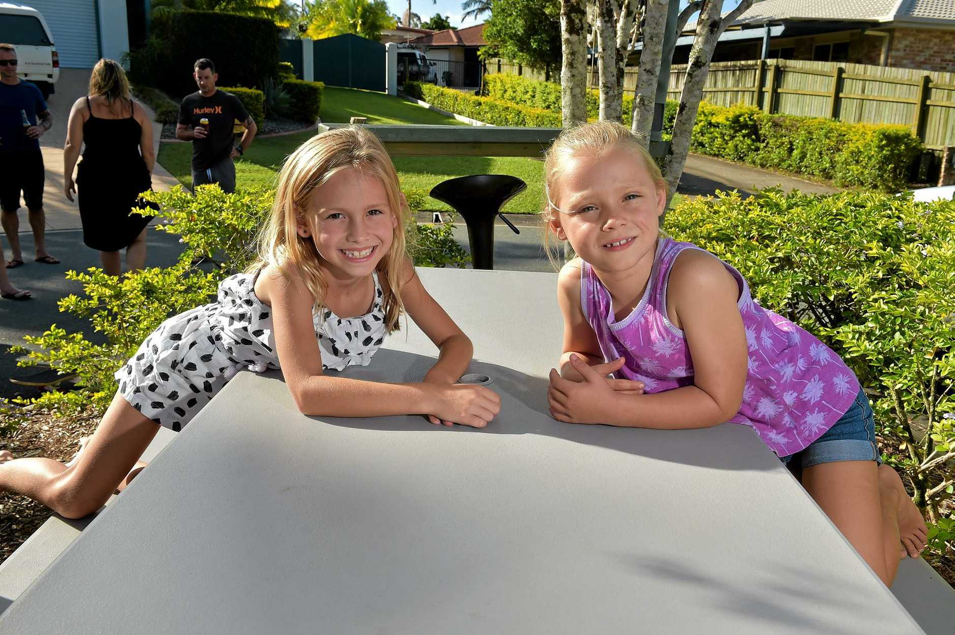 Residents of Chablis Court, Buderim, want to keep their picnic table at the end of their street despite an order from Council to remove it. Kirra Bernard ,8, and Ayla McCallum,5, want to keep the table.