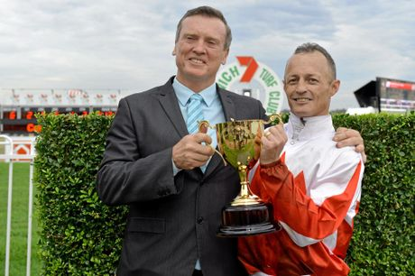WINNERS: Damian Browne with trainer David Vandyke after the pair combined to win the Ipswich Cup with Maurus.