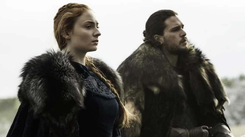 Kit Harington and Sophie Turner in a scene from season six episode nine of Game of Thrones.