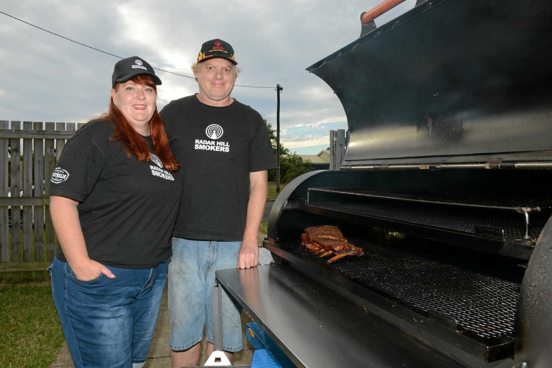 SMOKING FOOD: Paul and Bronwyn Durston slow roasting in the BBQ Smoker for their new business. Photo: Paul Donaldson / NewsMail