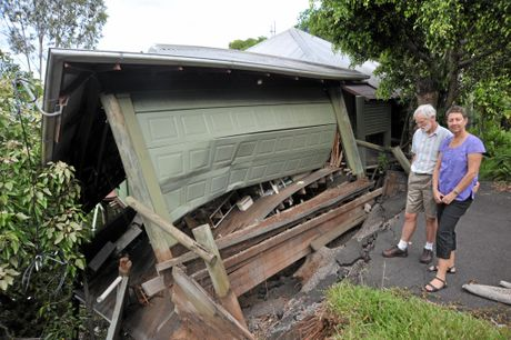 Houses in Durham Crescent, North Buderim, affected by recent landslides due to heavy rainfall - Peter and Becky (Rebecca but she prefers Becky) Francis outside their home at 17 Durham Crescent.