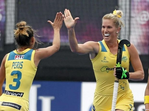 ON TARGET: Jodie Kenny celebrates scoring the Hockeyroos' second goal against New Zealand.