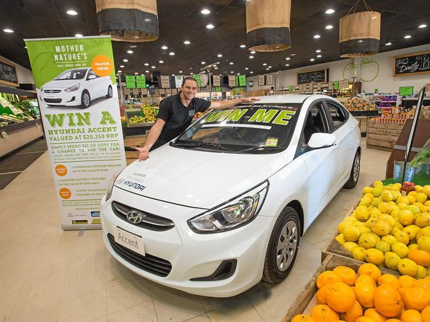UP FOR GRABS: Mother Nature's Coffs Harbour is giving away a car to a lucky shopper who spends more than $25 in store.