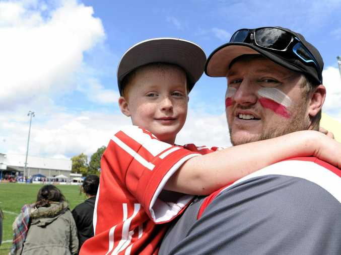 FAMILY MAN: Xavier Sullivan with his son Jaxon, 8, at the Group 2 grand final in 2014. Jaxon is one of four Sullivan children who were the catalyst to Xavier's move back to the mines.