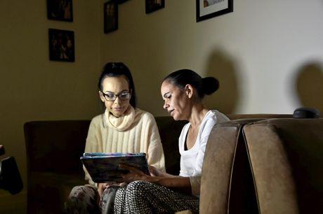 Layla Hooper, 22, looks through her bucket list with mum Sallyann Hall.