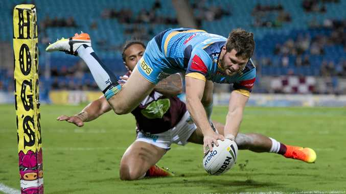 TRY TIME: Titans winger Anthony Don crosses to score in his side's 30-10 victory over the Sea Eagles.
