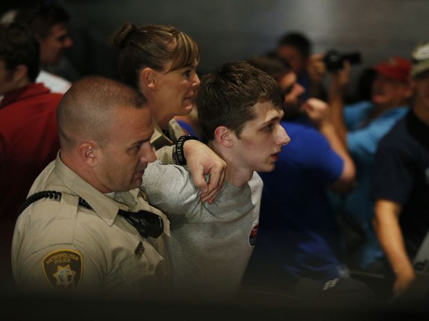 Michael Sandford is removed by police from a Donald Trump rally at the Treasure Island casino in Las Vegas on Saturday 18 June AAP