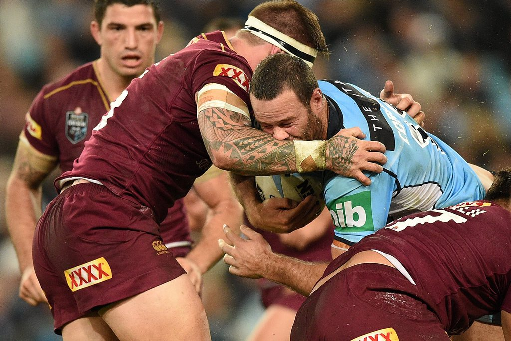Boyd Cordner of the Blues is tackled by Josh McGuire of the Maroons during State of Origin Game I earlier this year.