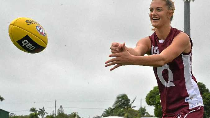 KICKING GOALS: A talented young sportswoman, Sarina's Lauren Bella hopes to play for the Brisbane Lions one day.