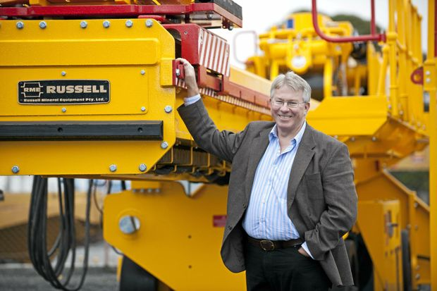 BIG BUSINESS: Dr John Russell with a Russell mill relining machine destined for export.