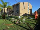 DEVASTATION: Residents clean up after a storm in Akeringa Place, Mooloolooaba.