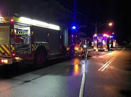 Tweed Heads firefighters respond to a houseboat fire at Gollan Dr, West Tweed.