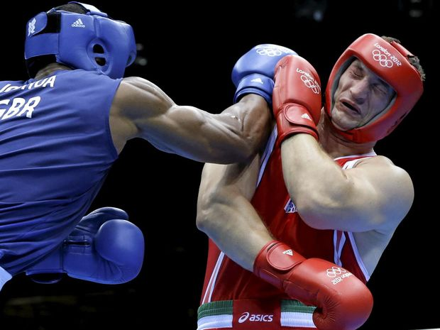 HEAVY HITTERS: Italy's Roberto Cammarelle (right) fights Britain's Anthony Joshua in a super heavyweight over 91-kg gold medal boxing match at the 2012 Olympics in London. Joshua won the gold.