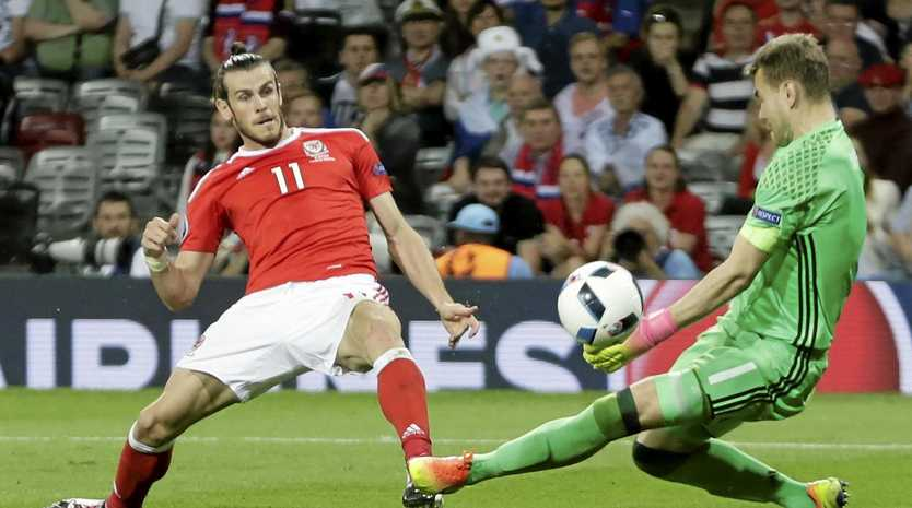 TOP SCORER: Wales star Gareth Bale scores his side's third goal past Russia goalkeeper Igor Akinfeev during the Euro 2016 Group B soccer match in Toulouse.