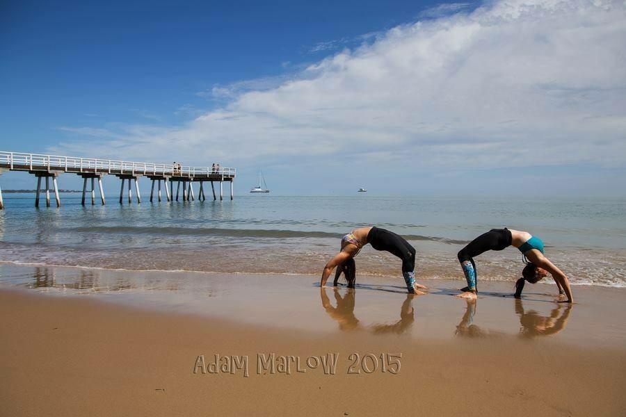 Yoga teacher's Jessica Wemmerslager and Rhian Hunter celebrate International Day of Yoga in Hervey Bay.