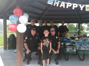 'Superhero' cops save autistic boy's birthday party