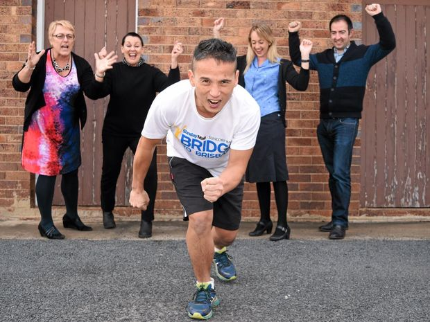 READY TO RUN: Doctor Richardy Hostiadi is cheered on by his colleagues as he prepares for the Susan Suduk OneDay to Conquer Cancer fundraiser run.