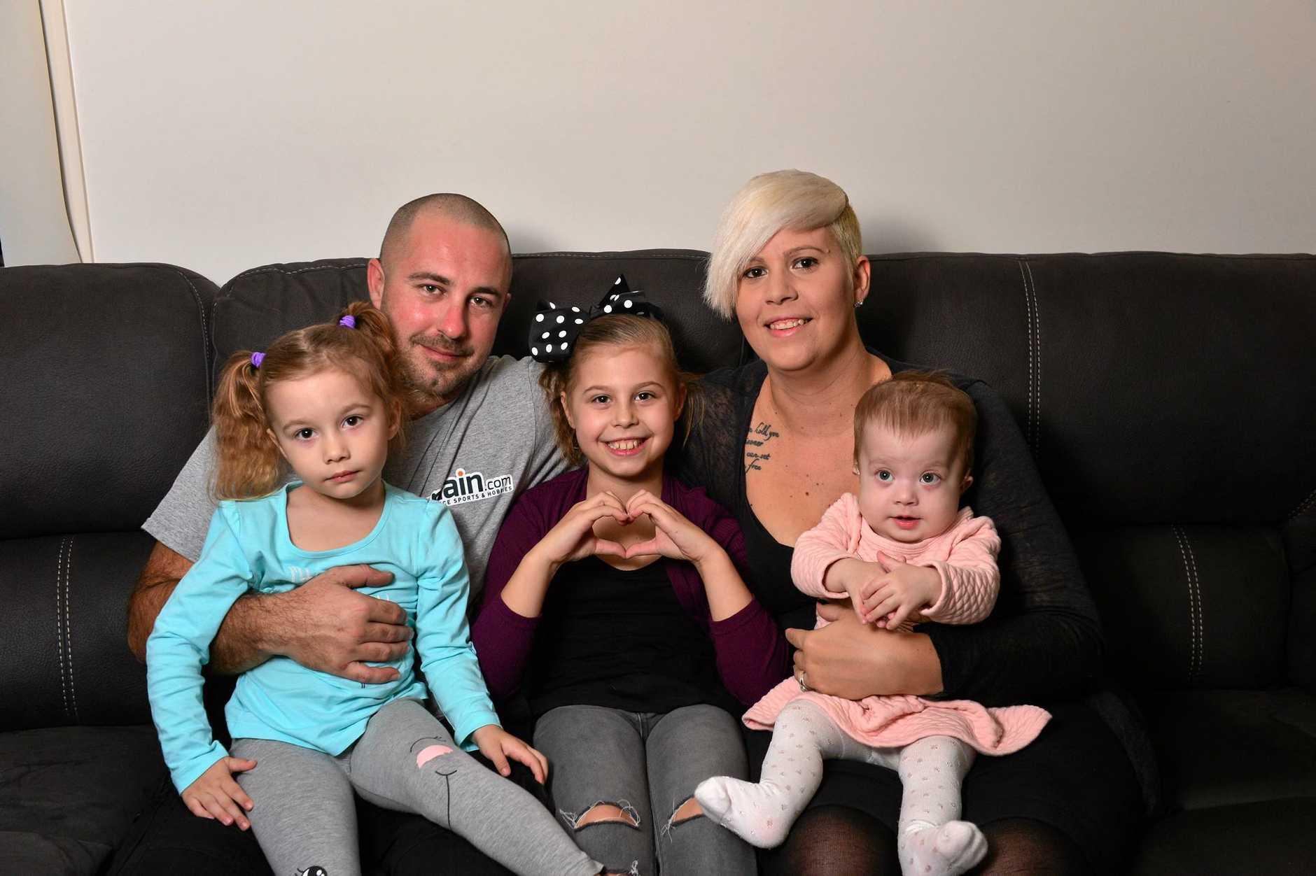 Kieran and Bec Van Jole with their children Alyssa, 9, Raven, 3 and Lyla, 11months.