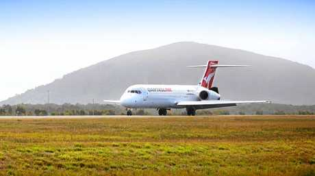 A Qantas jet lands at Sunshine Coast Airport.